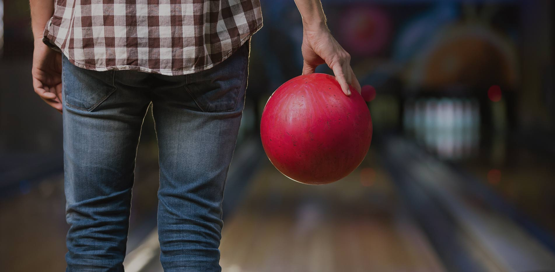 Man stood with Bowling Ball